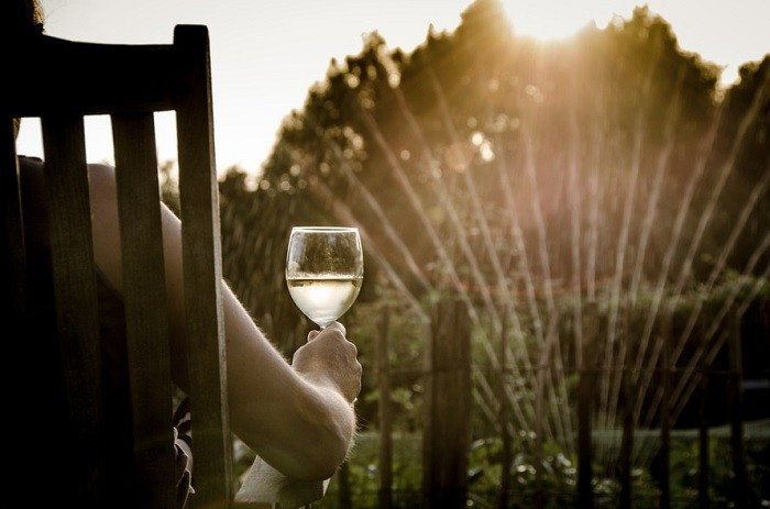 woman-relaxing-garden-wine