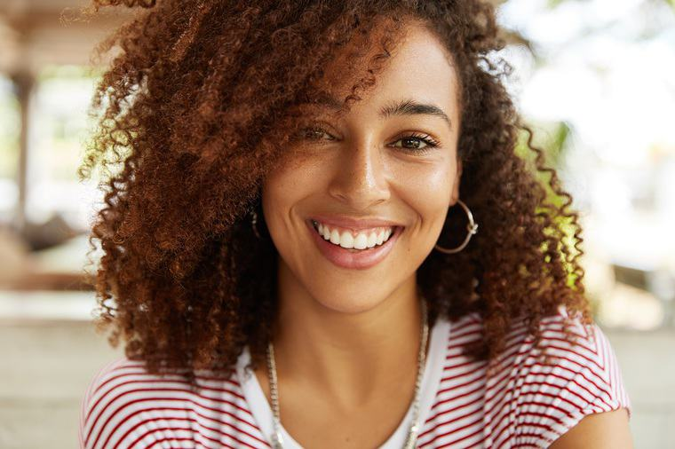 How a Mindful Smile Improves Your Happiness and Health