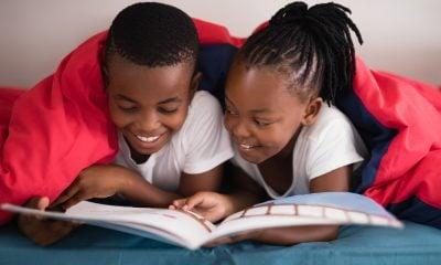 Siblings Reading Book