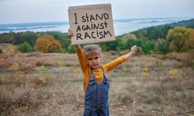 A Little Girl Standing Against Anti Racism