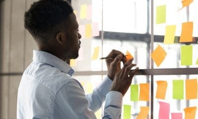 A Man Writing on Sticky Notes