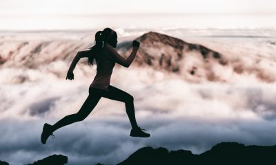 A Silhouette of a Woman Running
