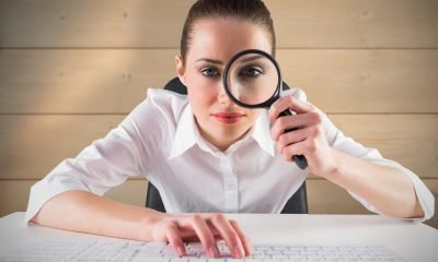 A Woman with Magnifying Glass