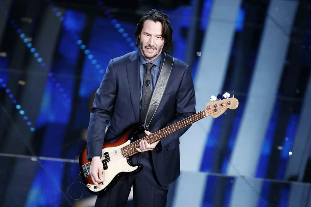 Keanu Reeves Holding a Guitar