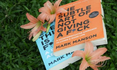 Two Books by Mark Manson in a Grass