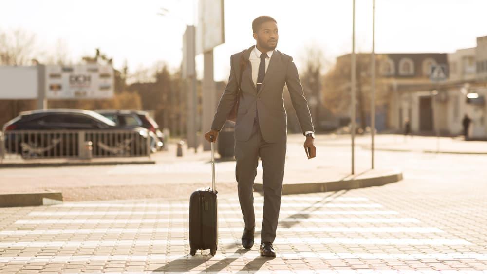 A Man Crossing in The Pedestrian Lane